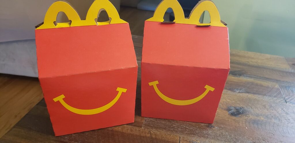 two happy meal boxes