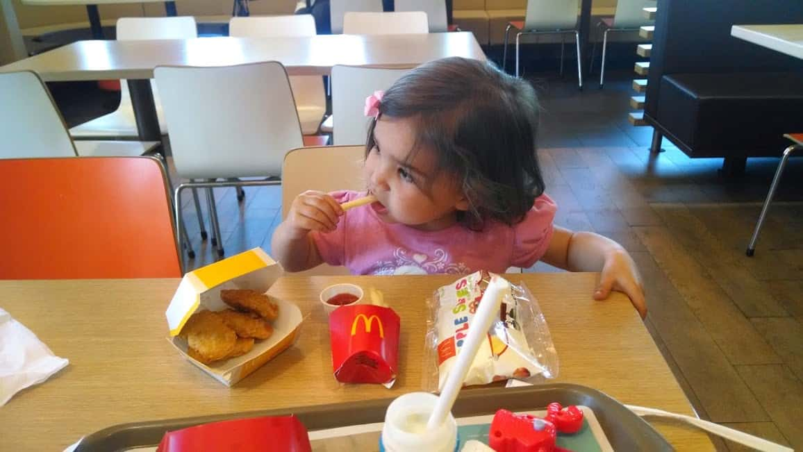 toddler eating a happy meal