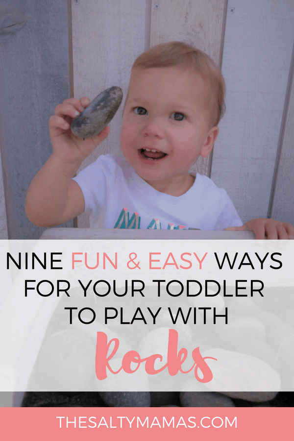 Toddler holding rock up; Text Overlay: Nine fun & easy ways for your toddler to play with rocks.