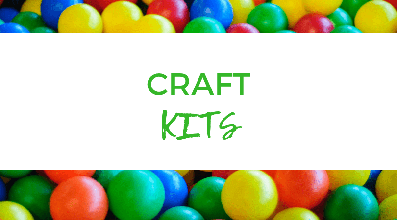 Backdrop of assorted M&M's. Text overlay: Craft Kits