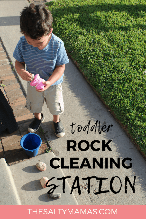 Toddler cleaning rock; Text overlay: Toddler rock cleaning station.