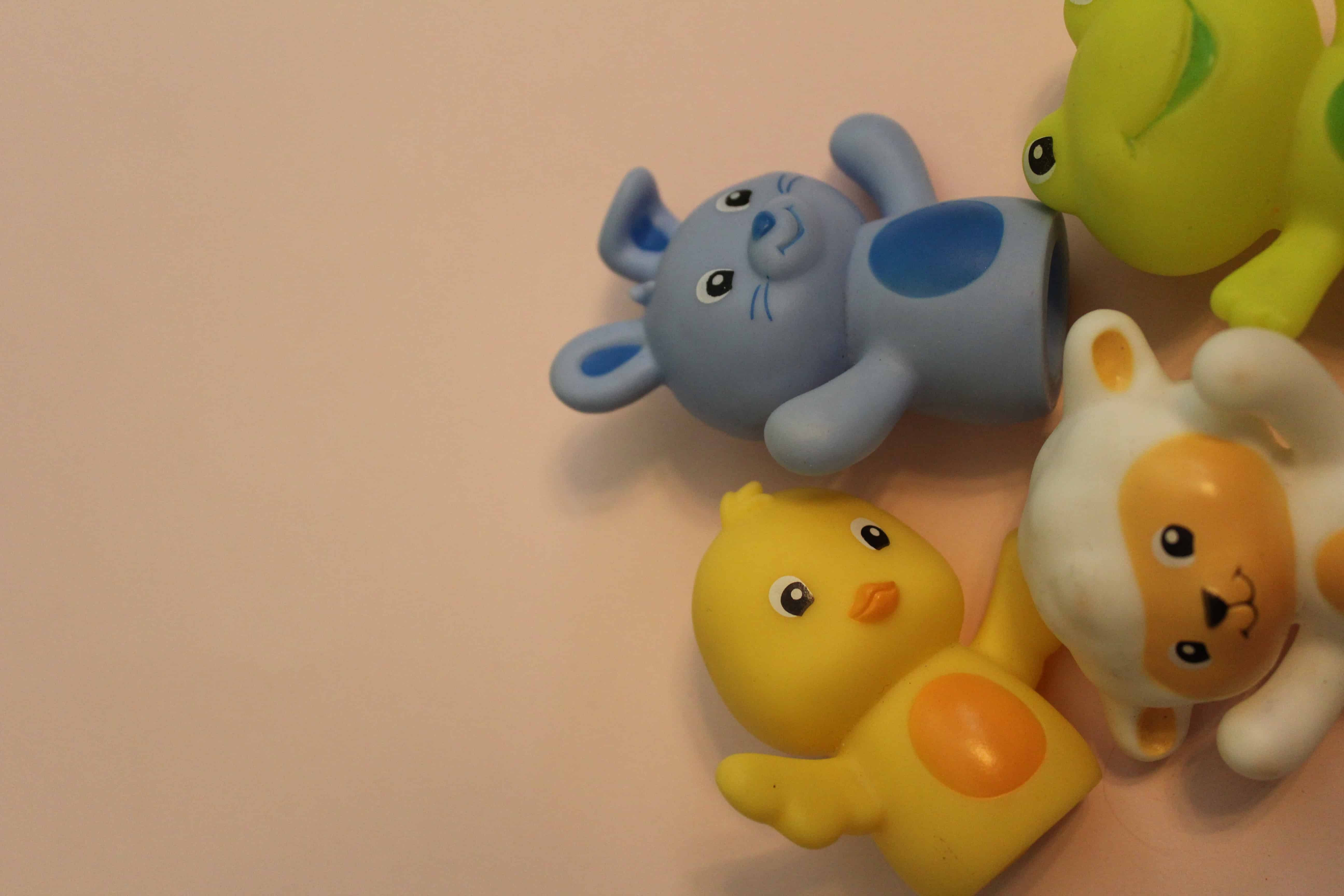 Finger puppets including one blue bunny, one yellow duck as well as a green frog and lamb.