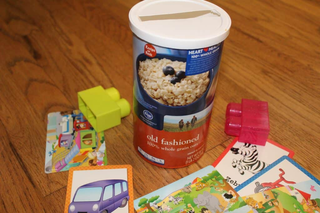 an oatmeal can with a slit in the lid; flash cards