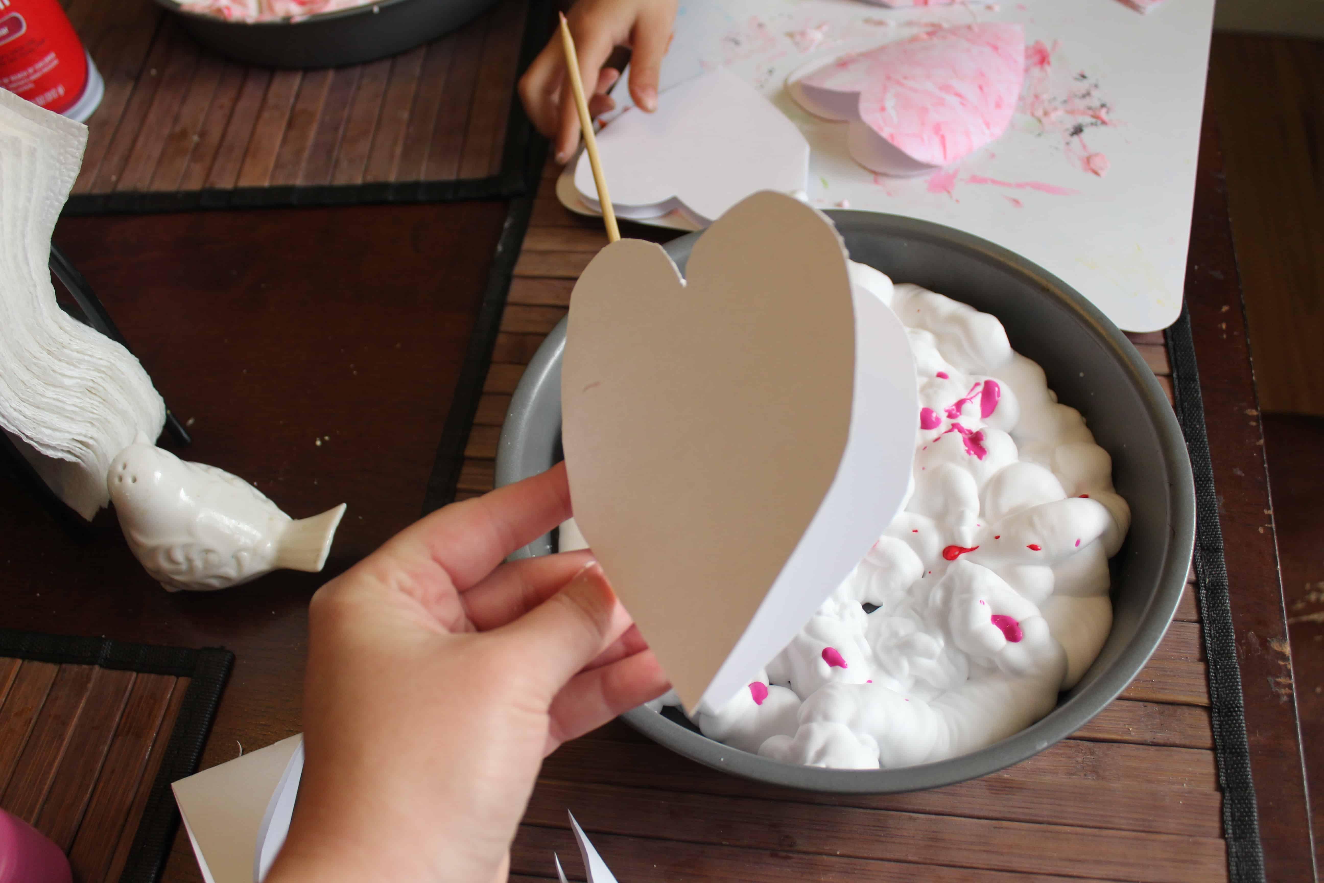 cardstock prints pressed into shaving cream paint