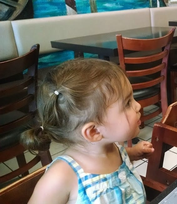 toddler with three-tiered pigtails