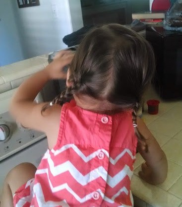 toddler with pigtails