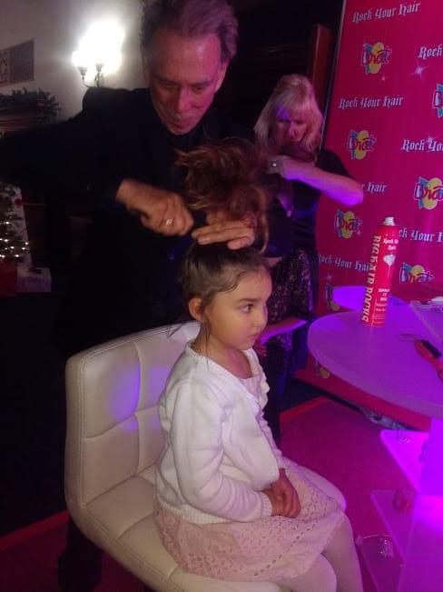 girl using rock your hair detangler