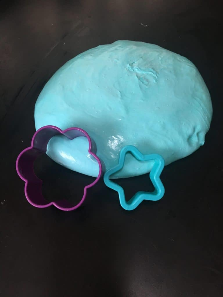 Baby blue Slime with star and flower cookie cutters