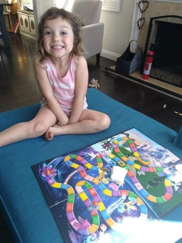 little girl playing candyland