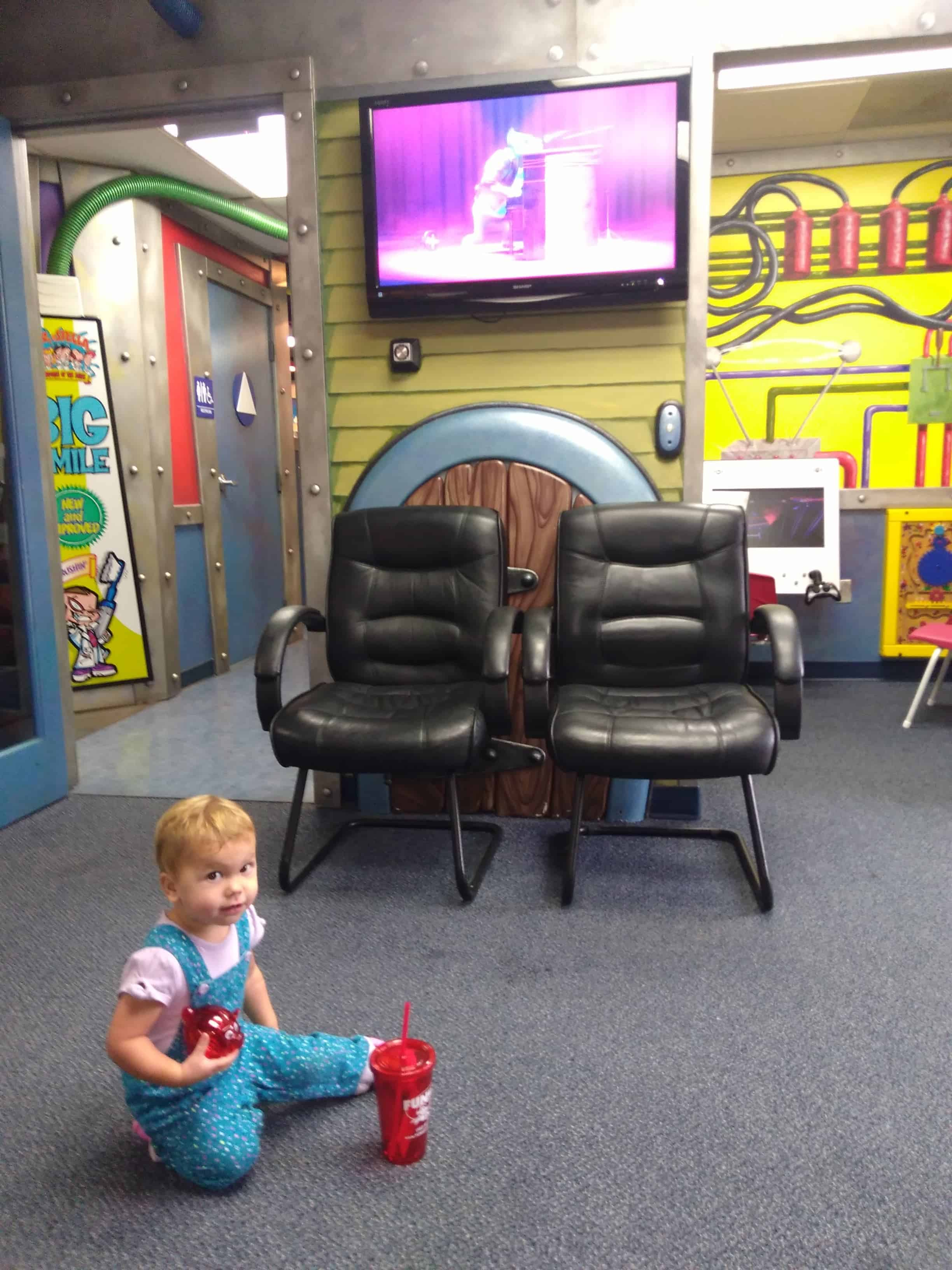 toddler in a kid-friendly dentist office