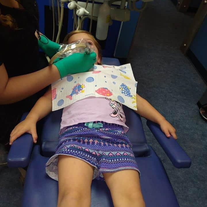 toddler getting her teeth cleaned