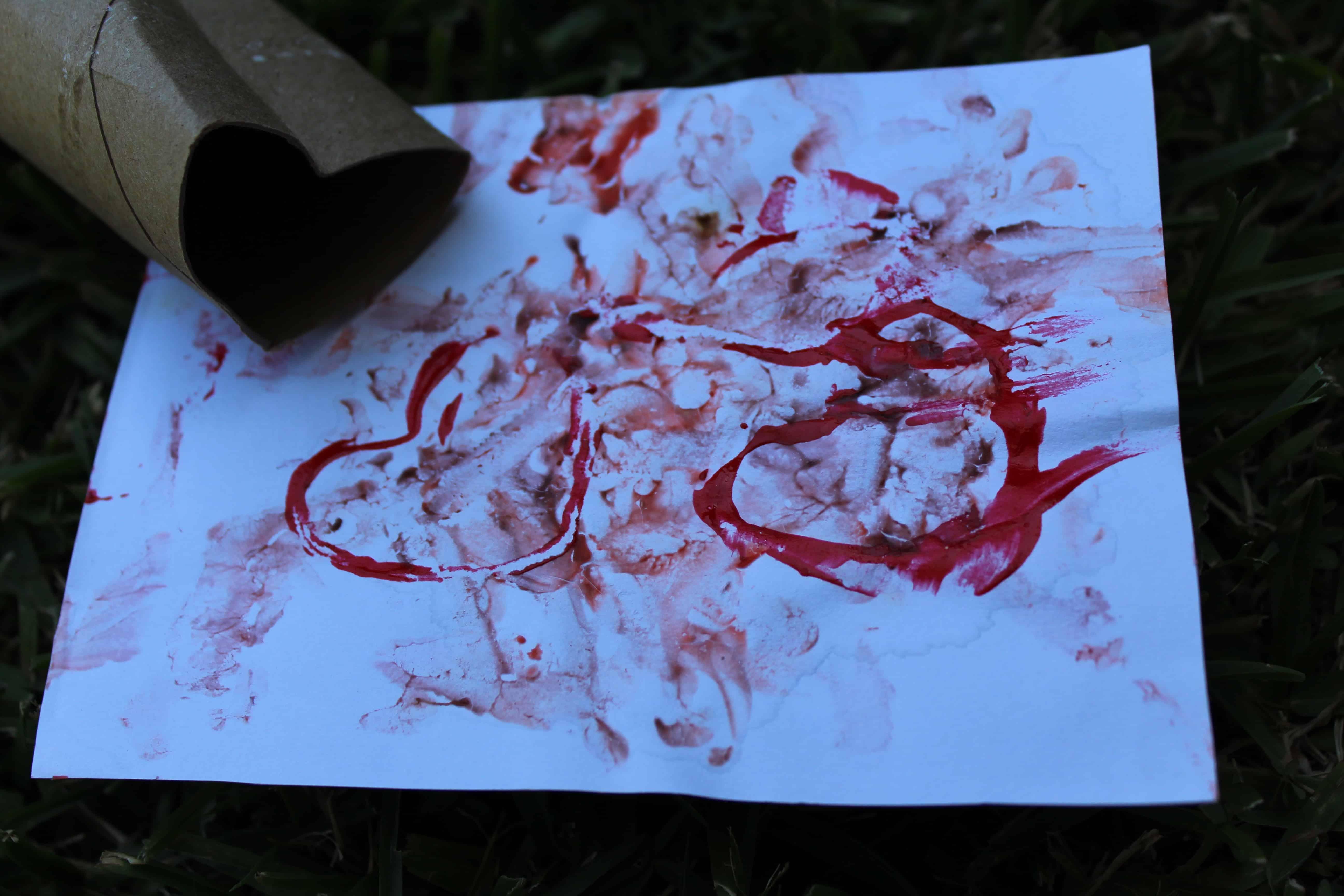 toilet paper tube bent into heart shape; yogurt painting