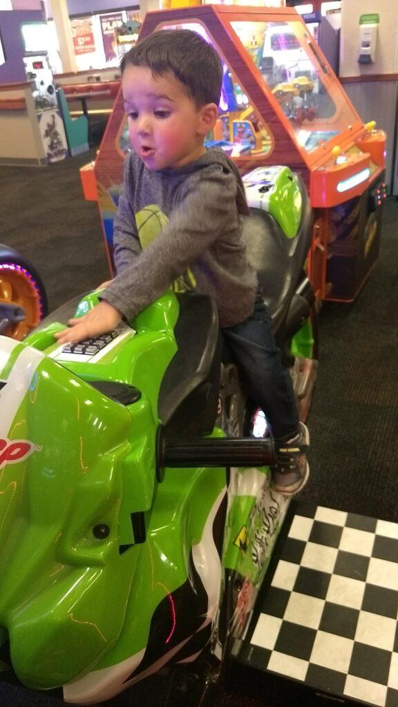 toddler on motorcycle game
