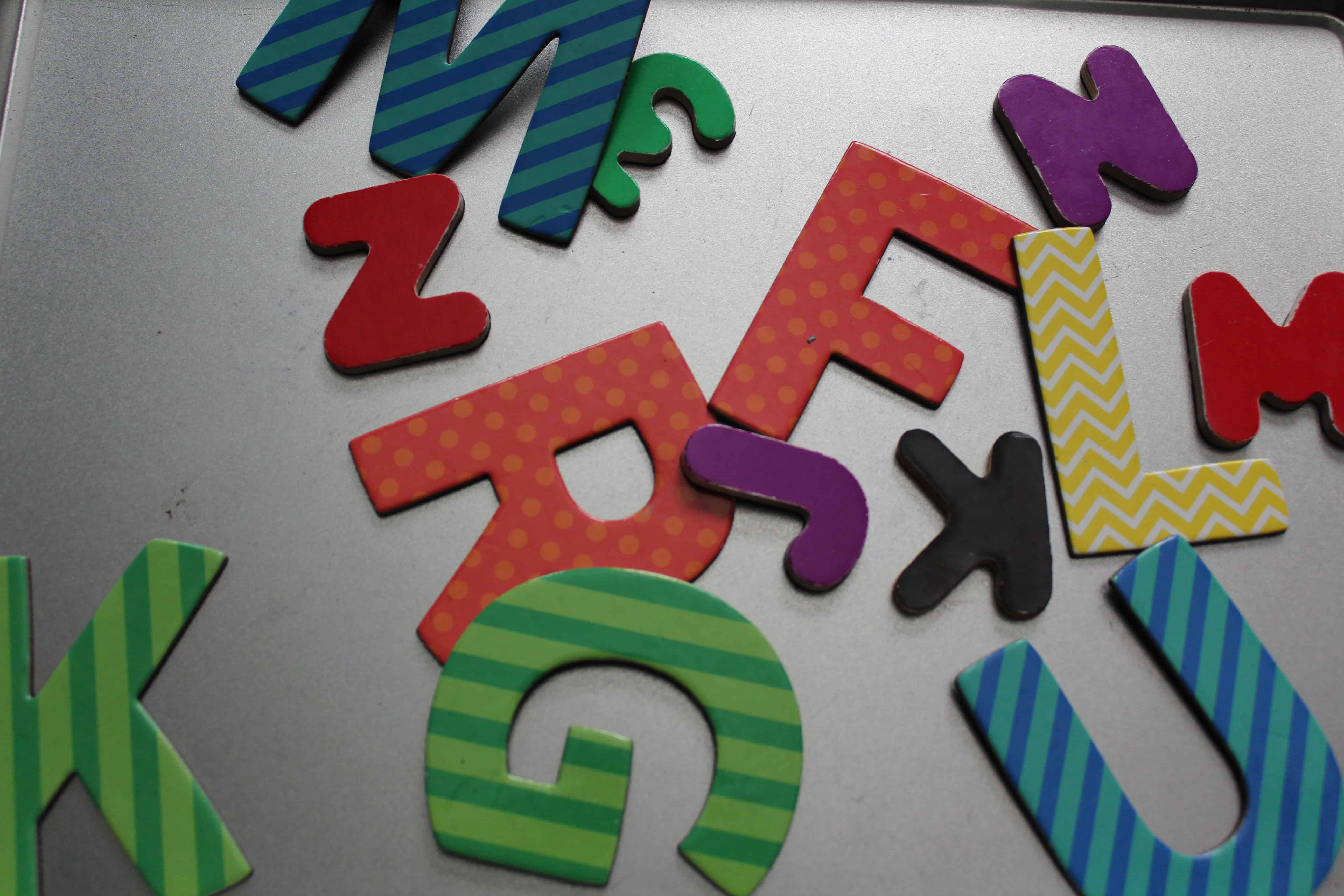Letter magnet cutouts on a baking sheet