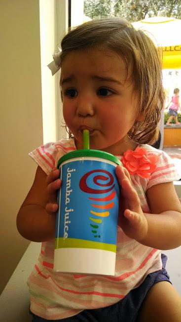 toddler drinking iron-rich smoothie
