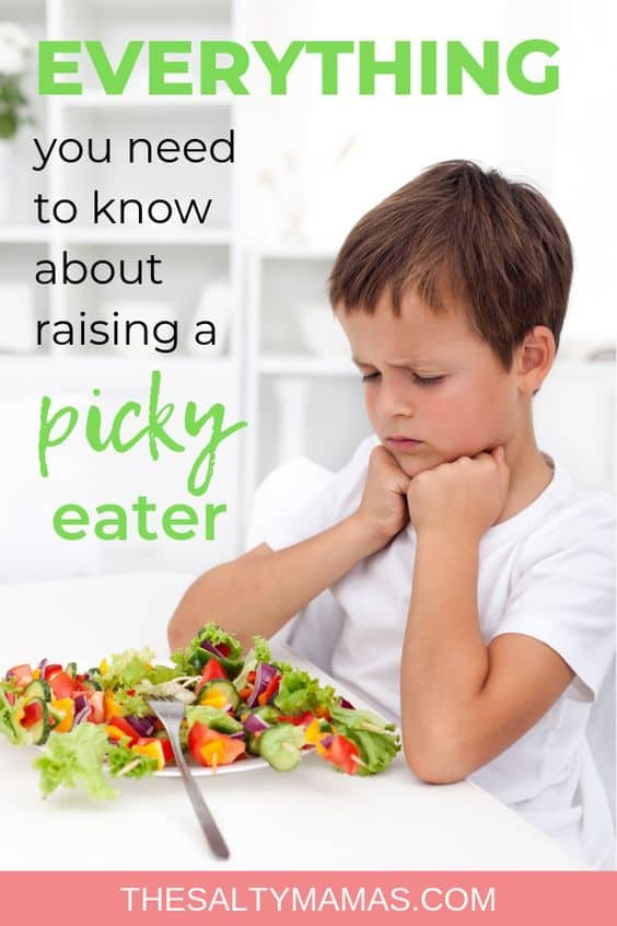 picky eater frowning at a salad