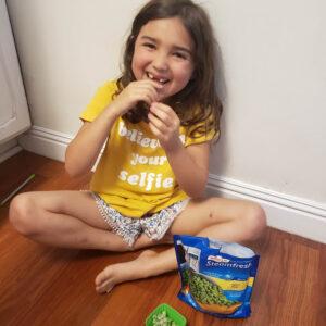 preschooler eating peas