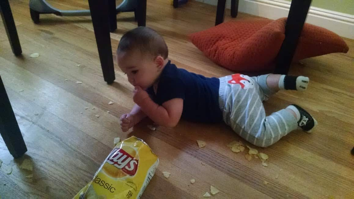 baby eating chips