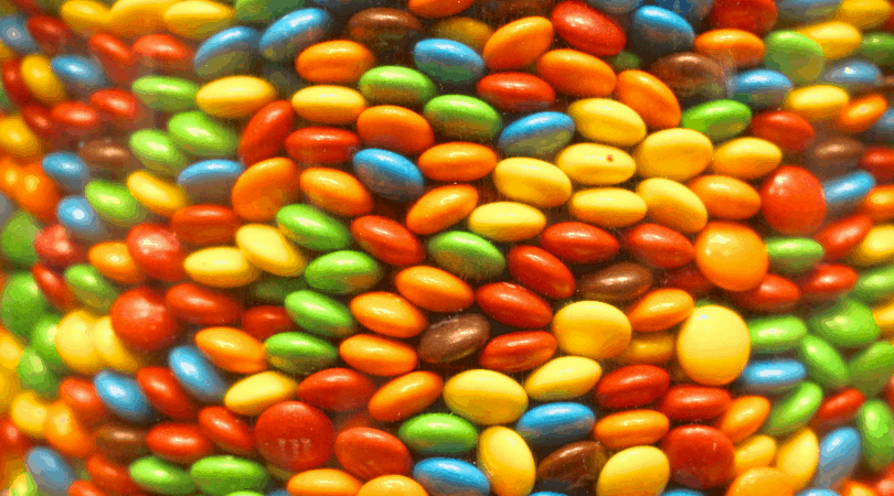 A glorious stack of M&M's all different colors.