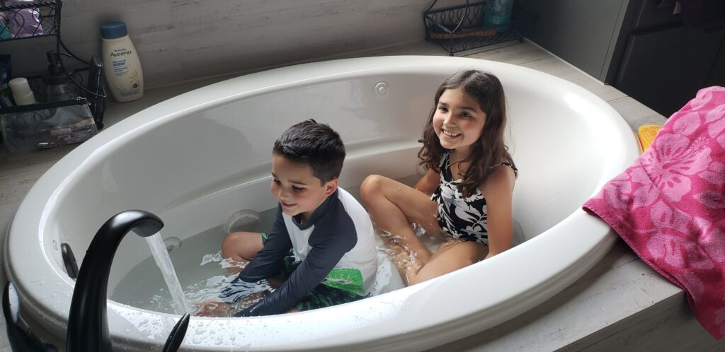 kids in suits in a bath tub