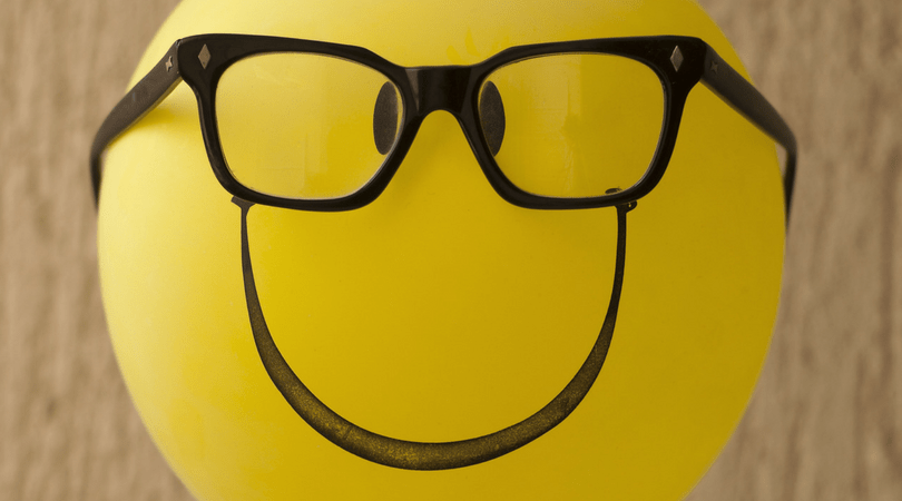Smiley face inflatable yellow balloon with glasses