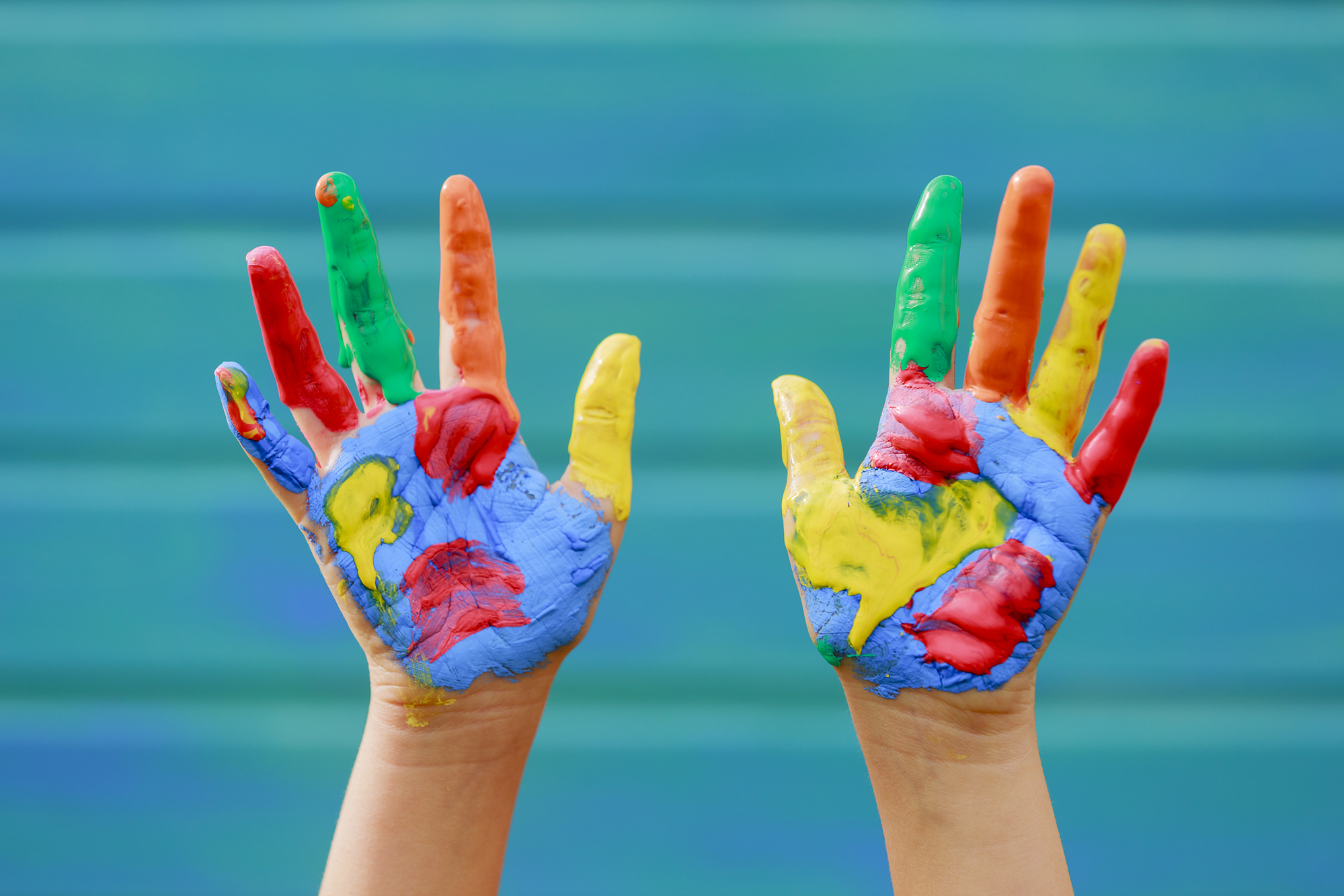 toddler hands with paint on them