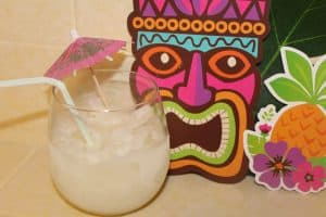 Need the perfect cocktail for your summer Luau? Try this icy alcoholic lemonade from TheSaltyMamas.com. #luaudrinksrecipe #summerdrinkrecipe #alcoholicslushie #raspberryvodkalemonade #vodkalemonade #bbqpartydrink #bbqdrinkrecipe