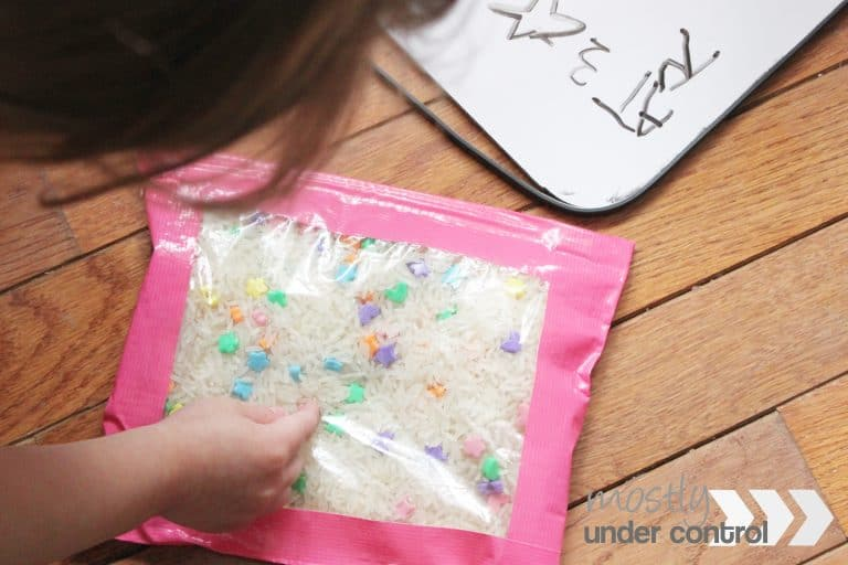 toddler using an ispy bag to practice colors