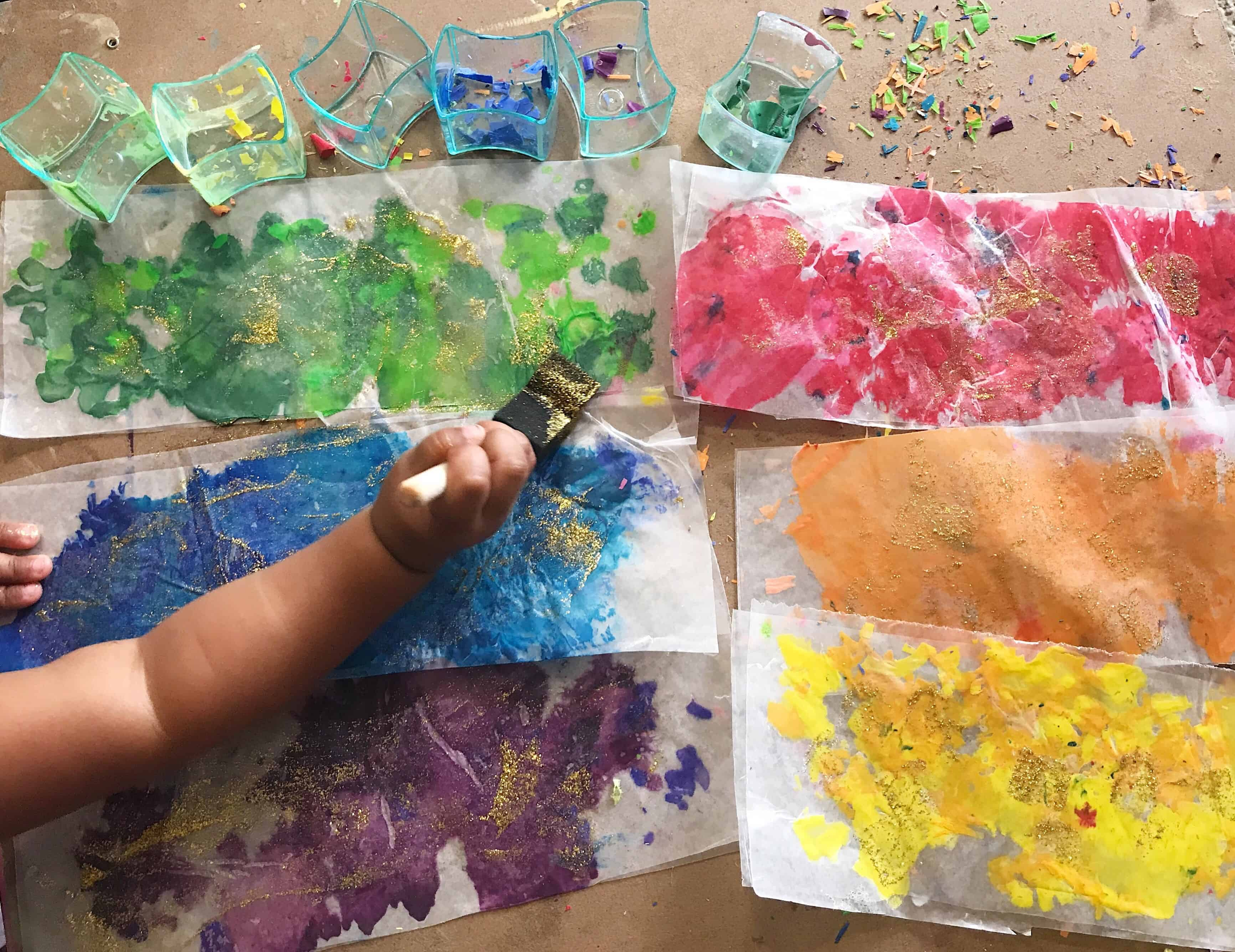 Melted crayon panted onto parchment paper by toddler.