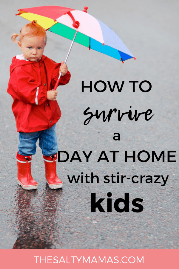 Toddler with rainbow umbrella; Text overlay: How to survive a day at home with stir-crazy kids