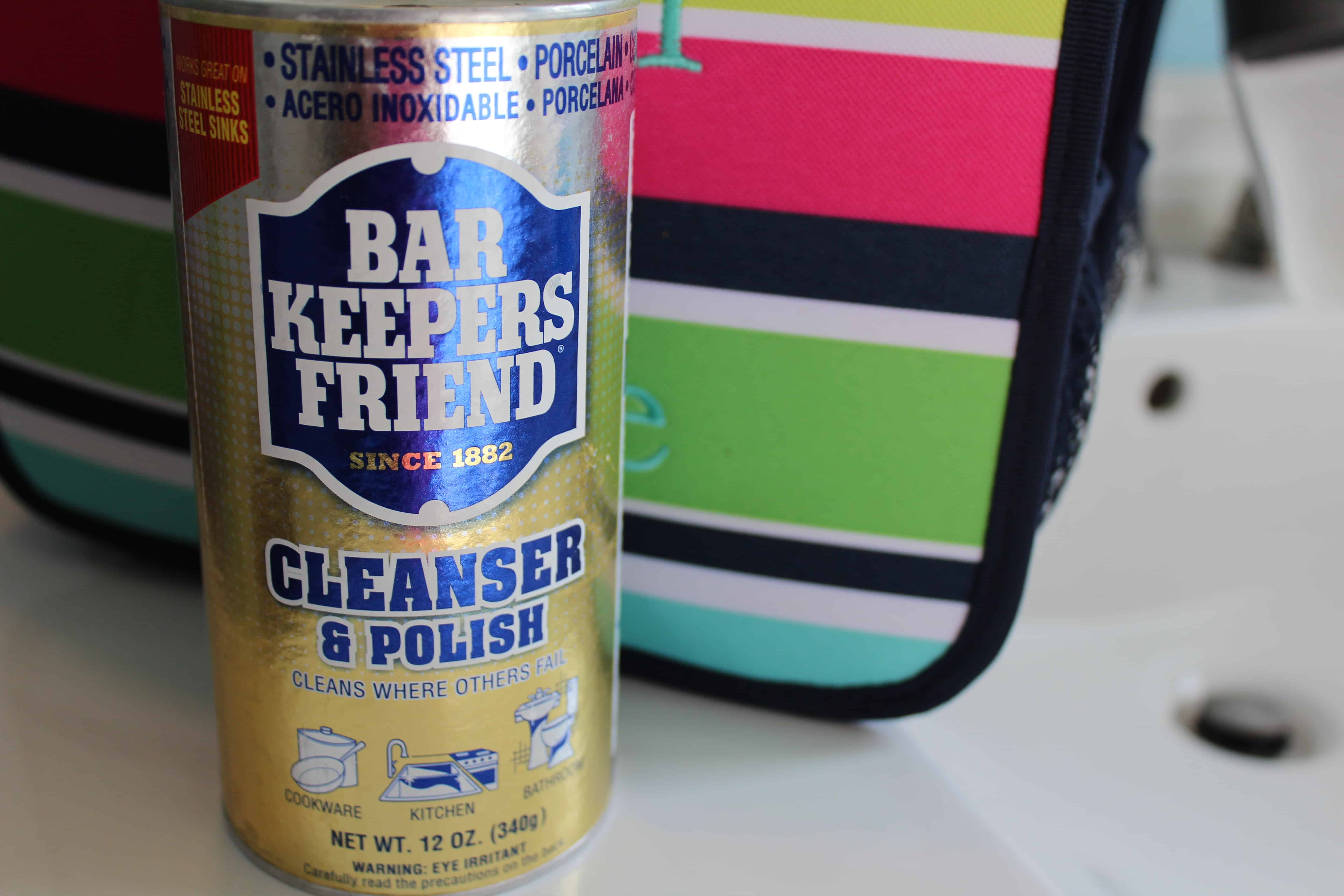 A can of barkeepers friend next to a caddy bag.