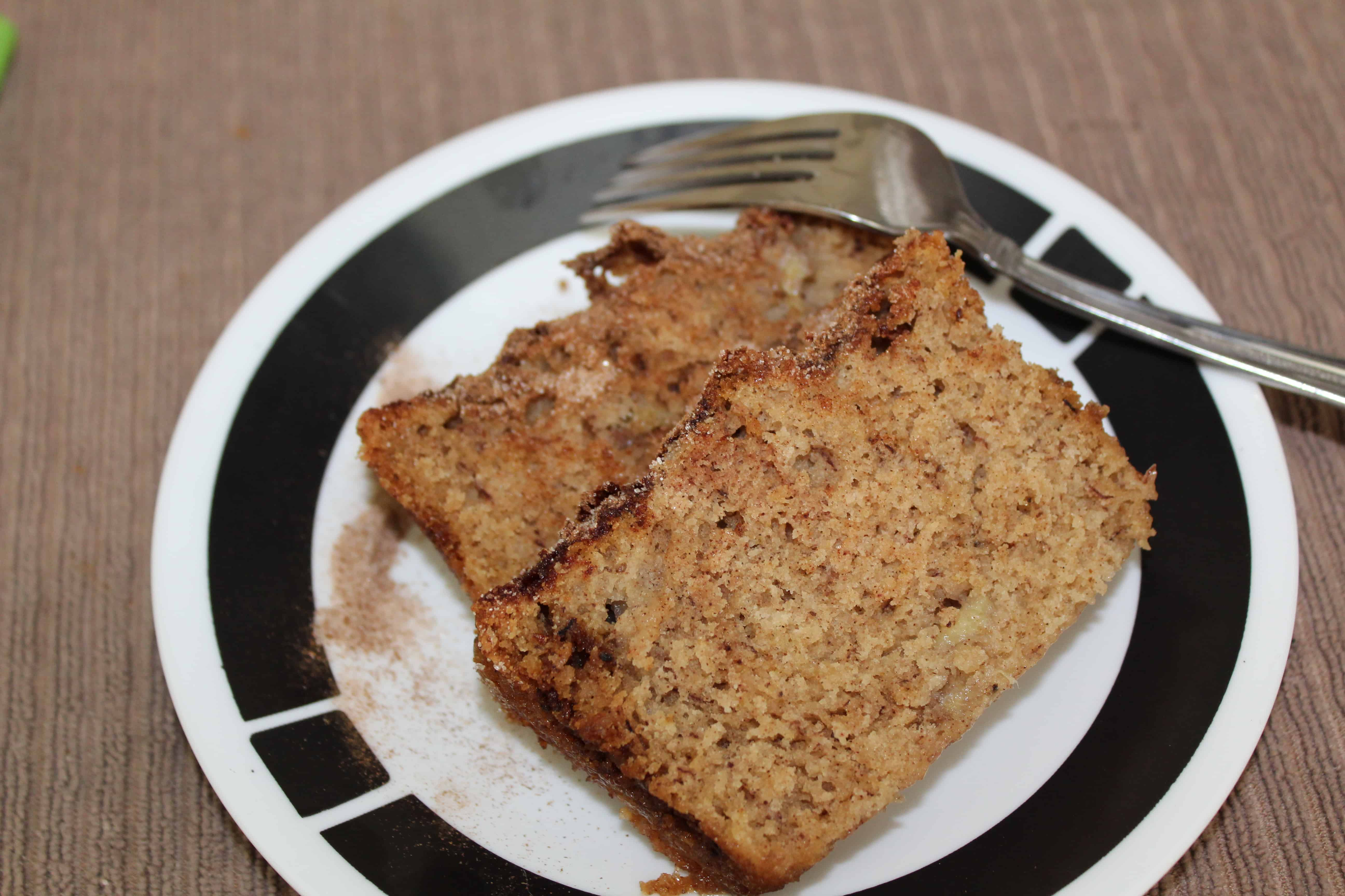 Two slices of banana bread on a plate.