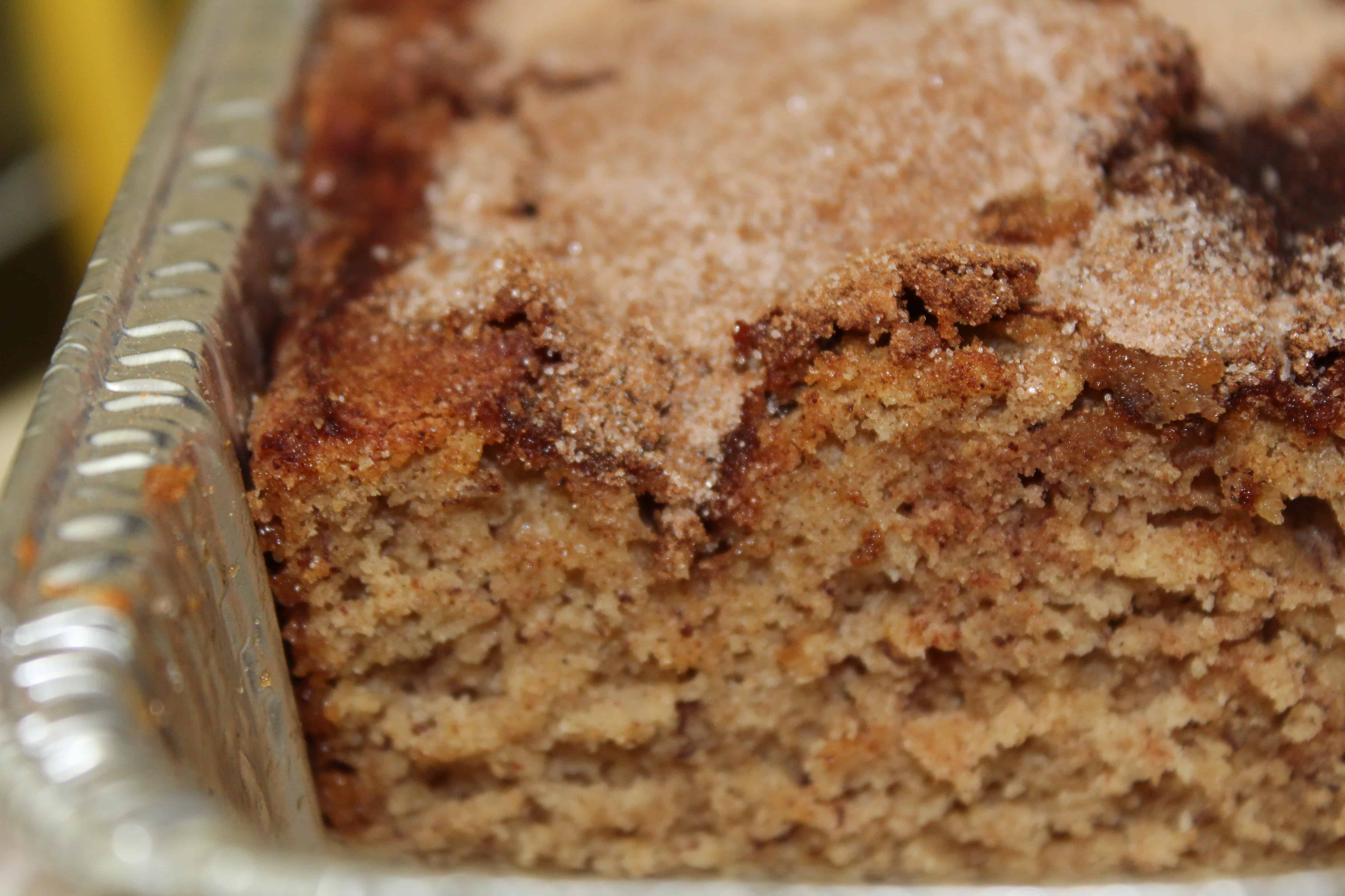Cooked banana bread cut into to show the inside.
