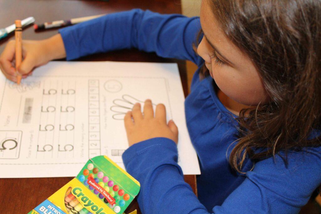 kindergartener doing a worksheet