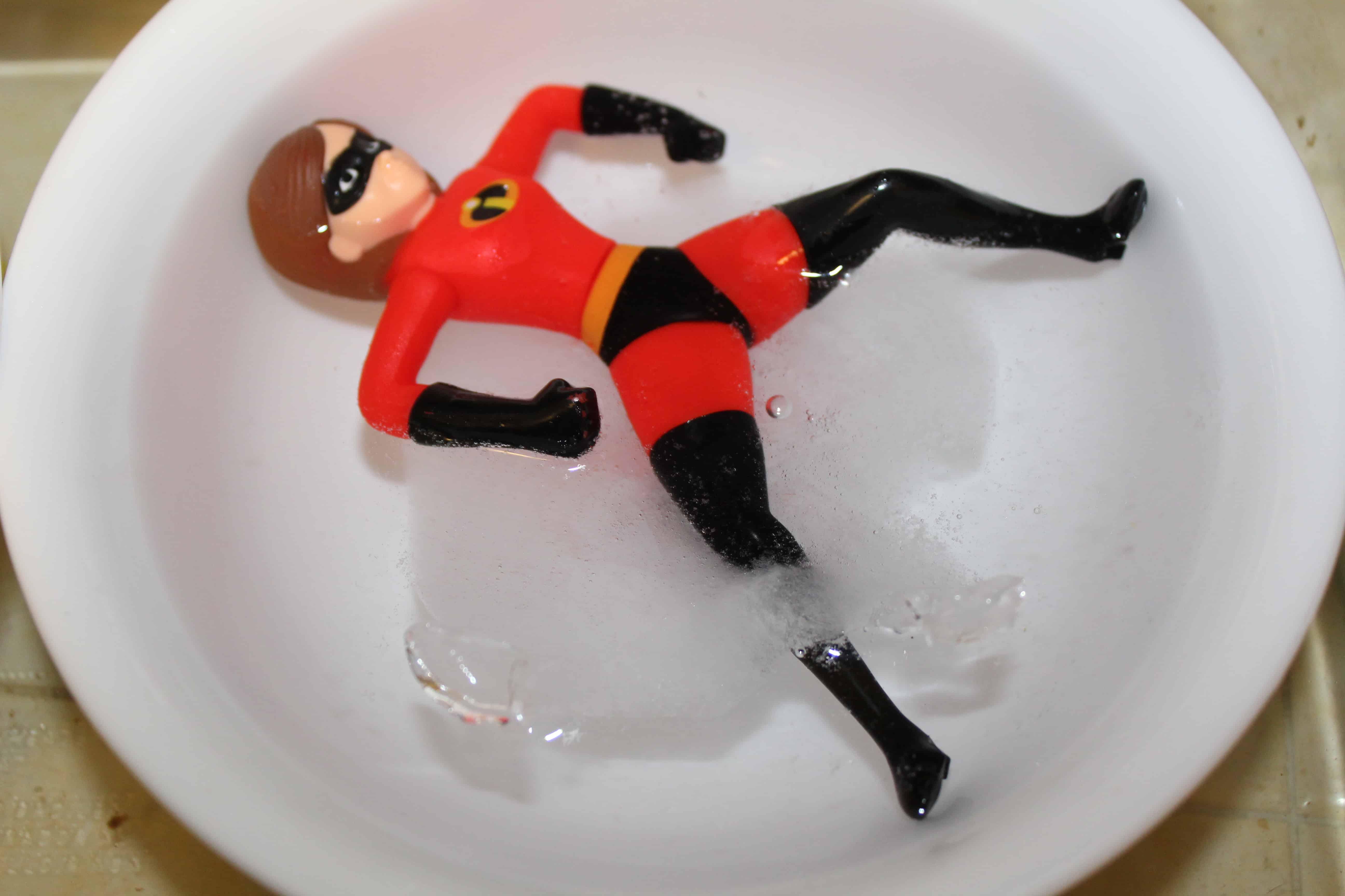 Elastigirl defrosting in a bowl of warm water.