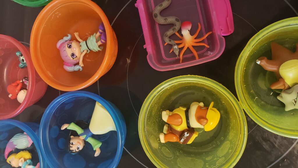 plastic toys arranged in bowls