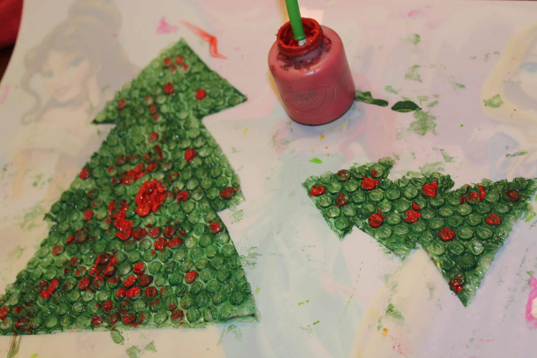 Dried Christmas tree cut out and painted on.