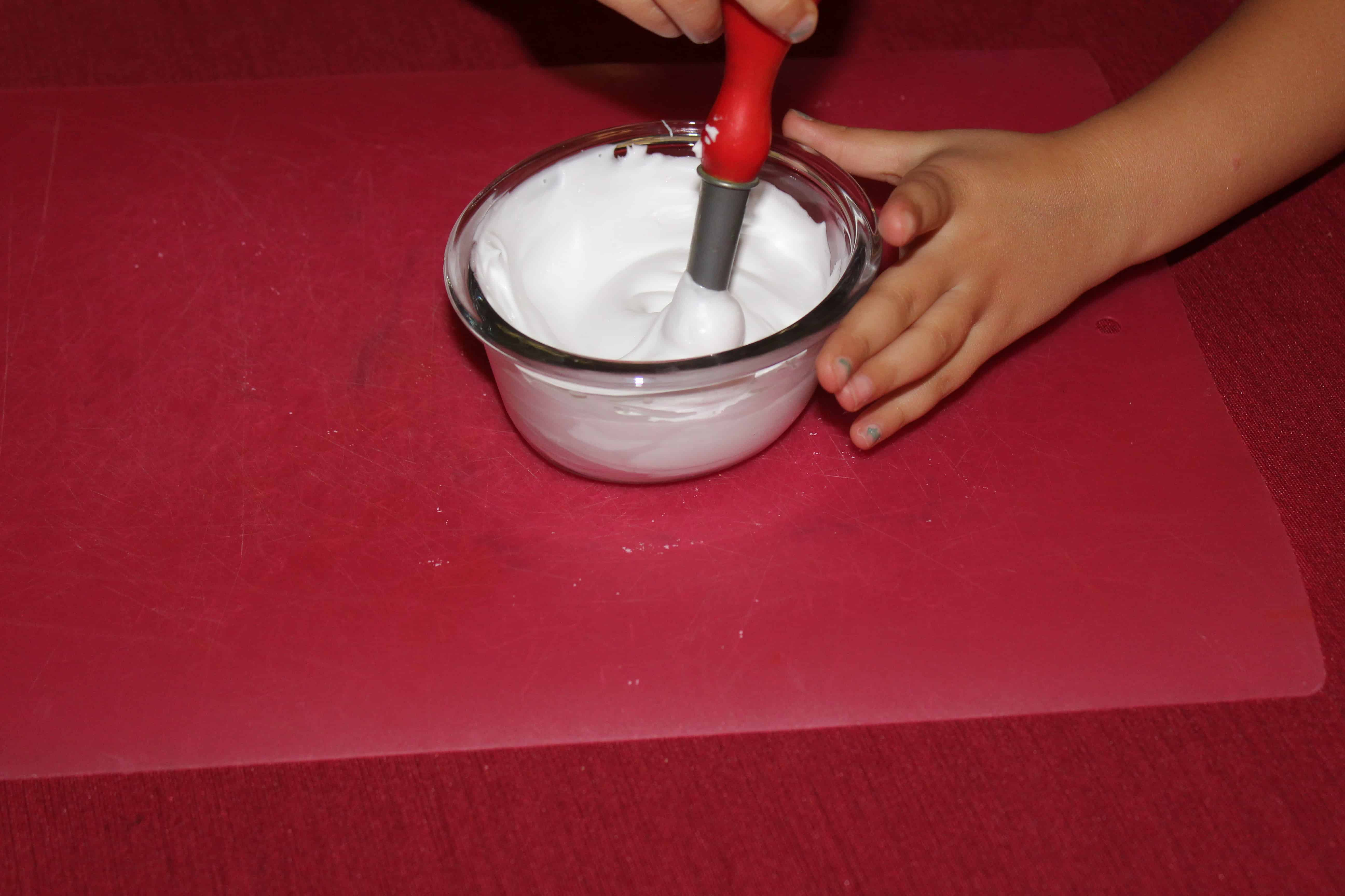 child painting with puffy paint