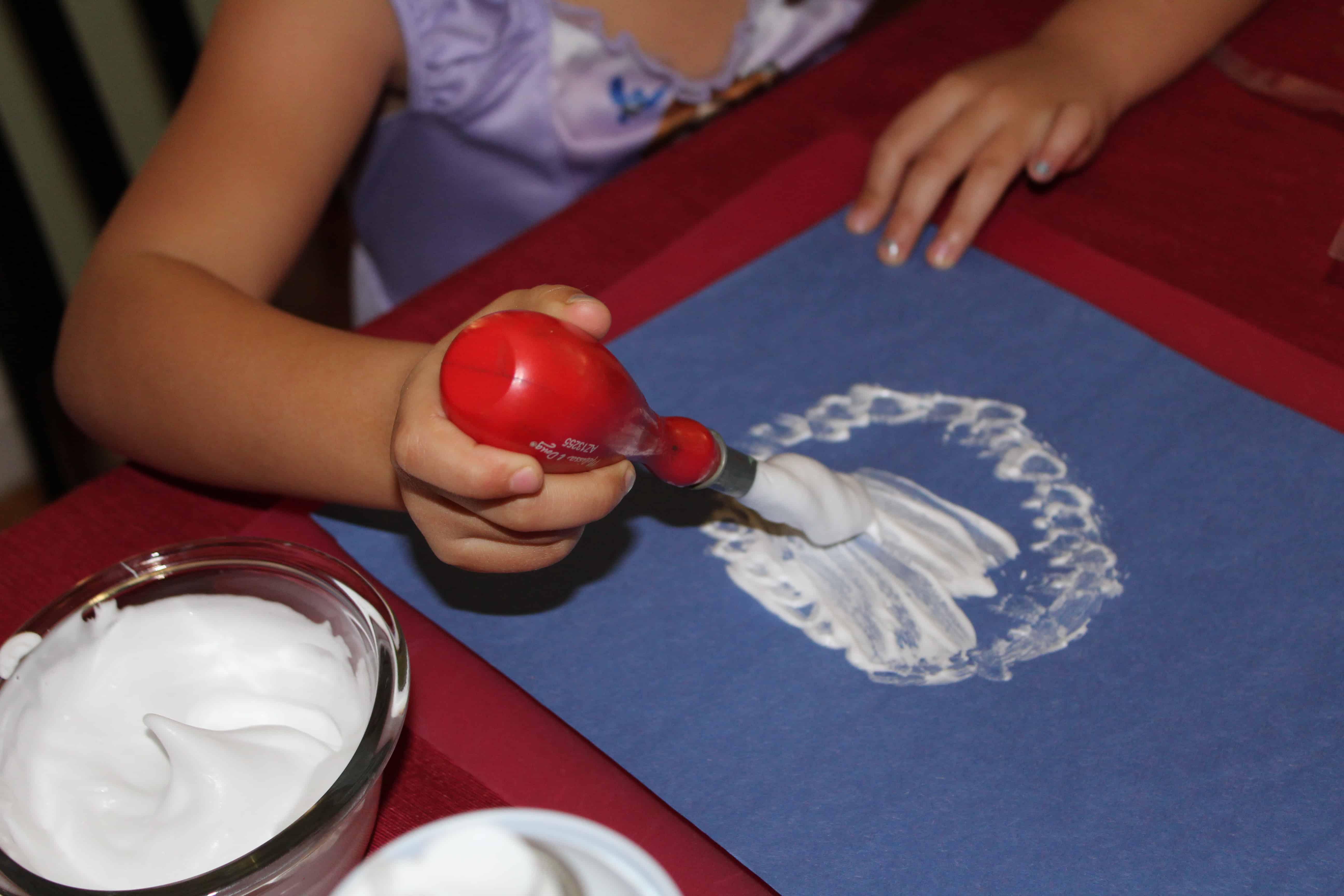 preschooler painting with shaving cream