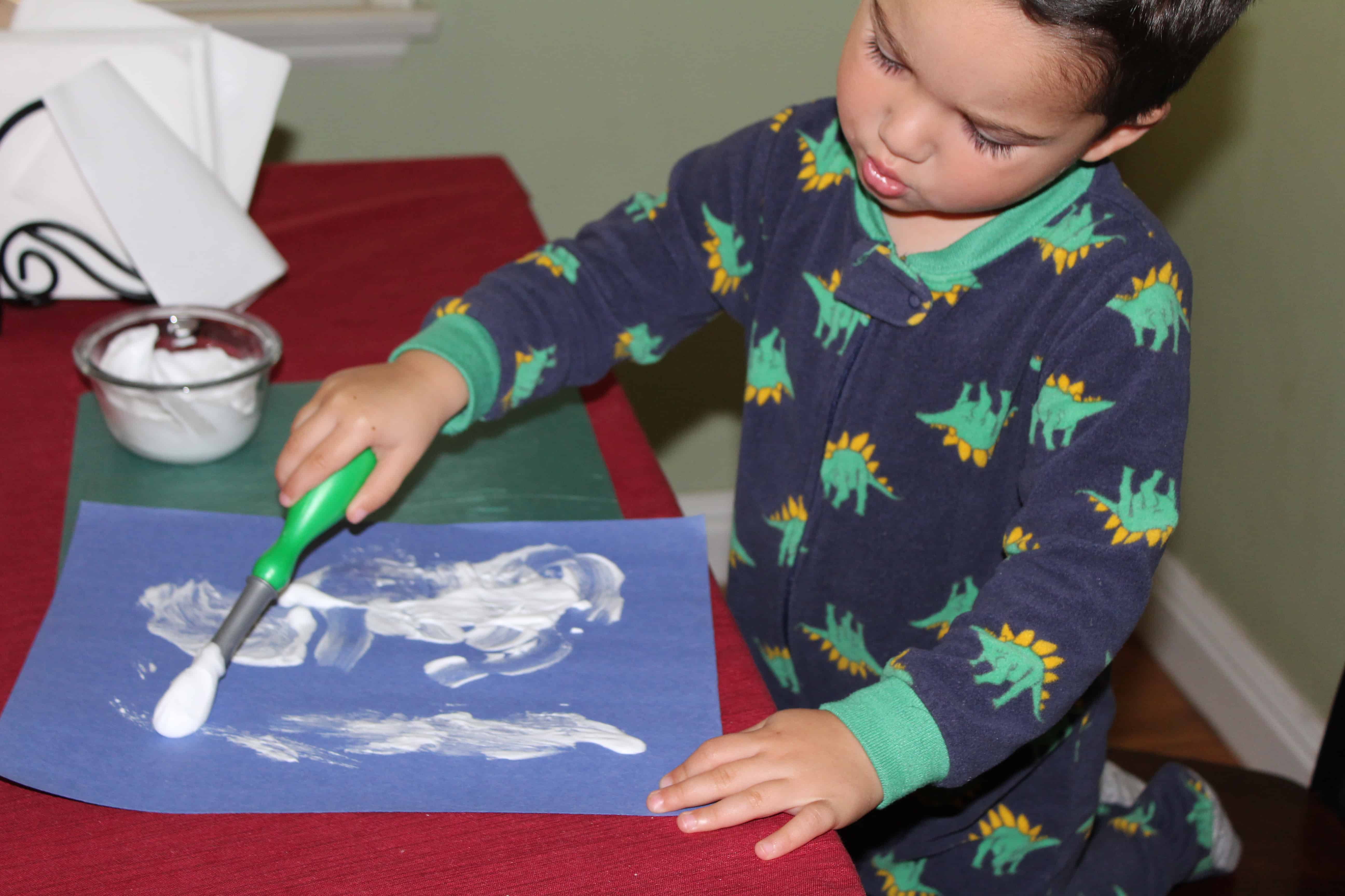 toddler painting with shaving cream