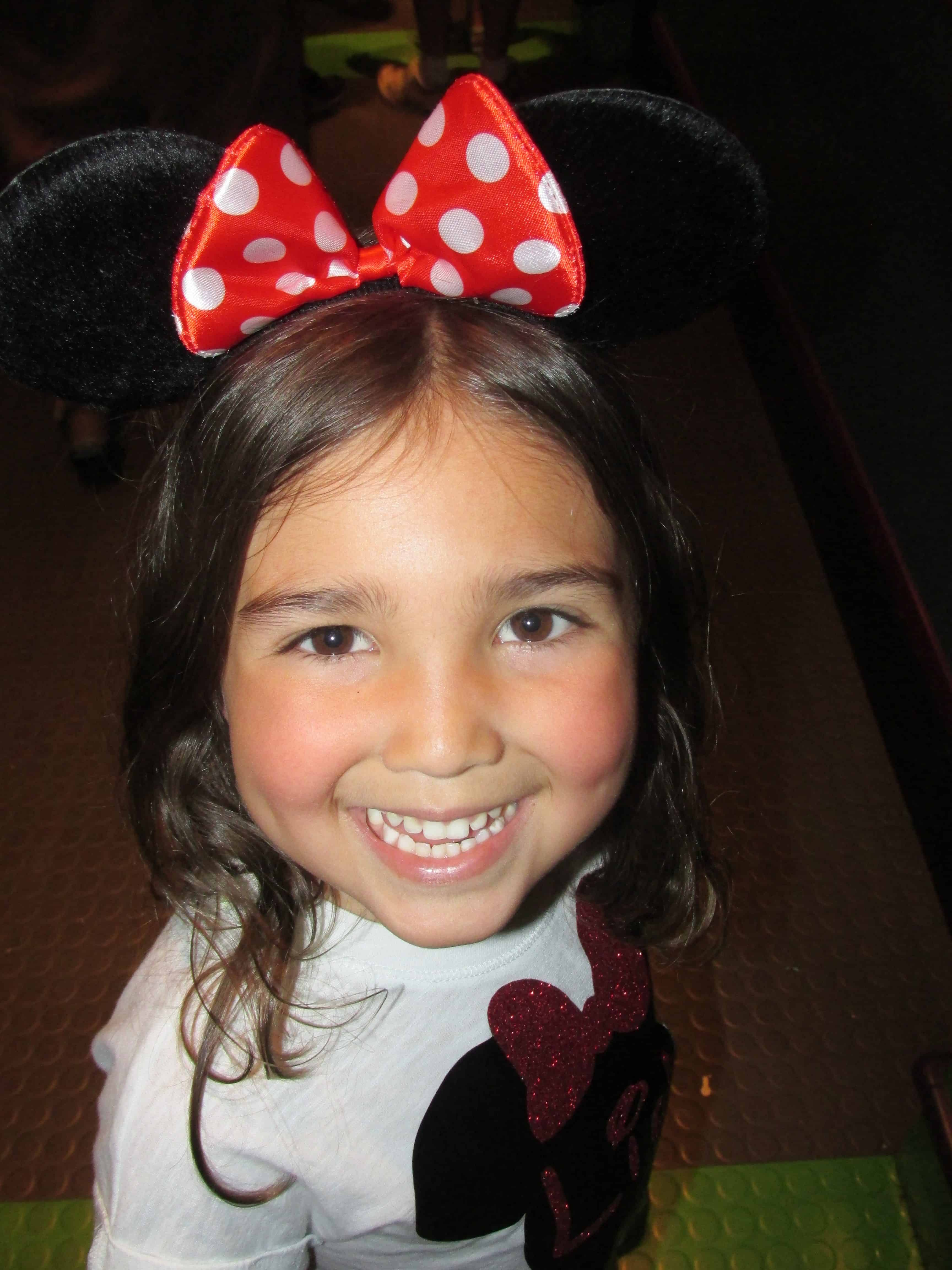 Little Lila with a red bow with white spots.