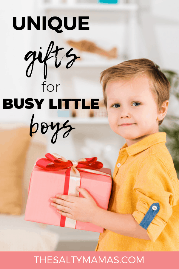 boy holding gift; text: unique gifts for busy little boys