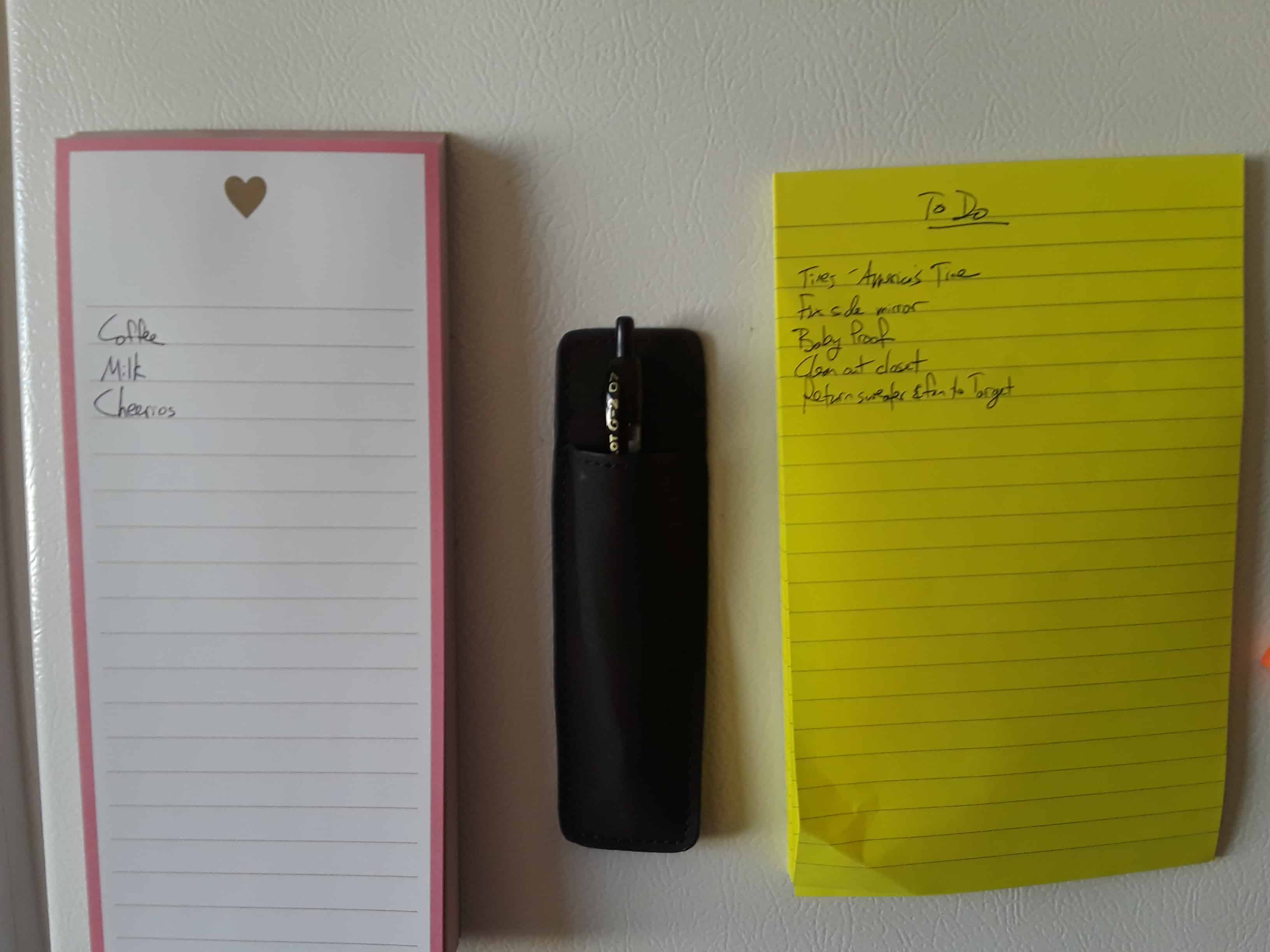 Two notepads and a magnetic pencil cup holder.