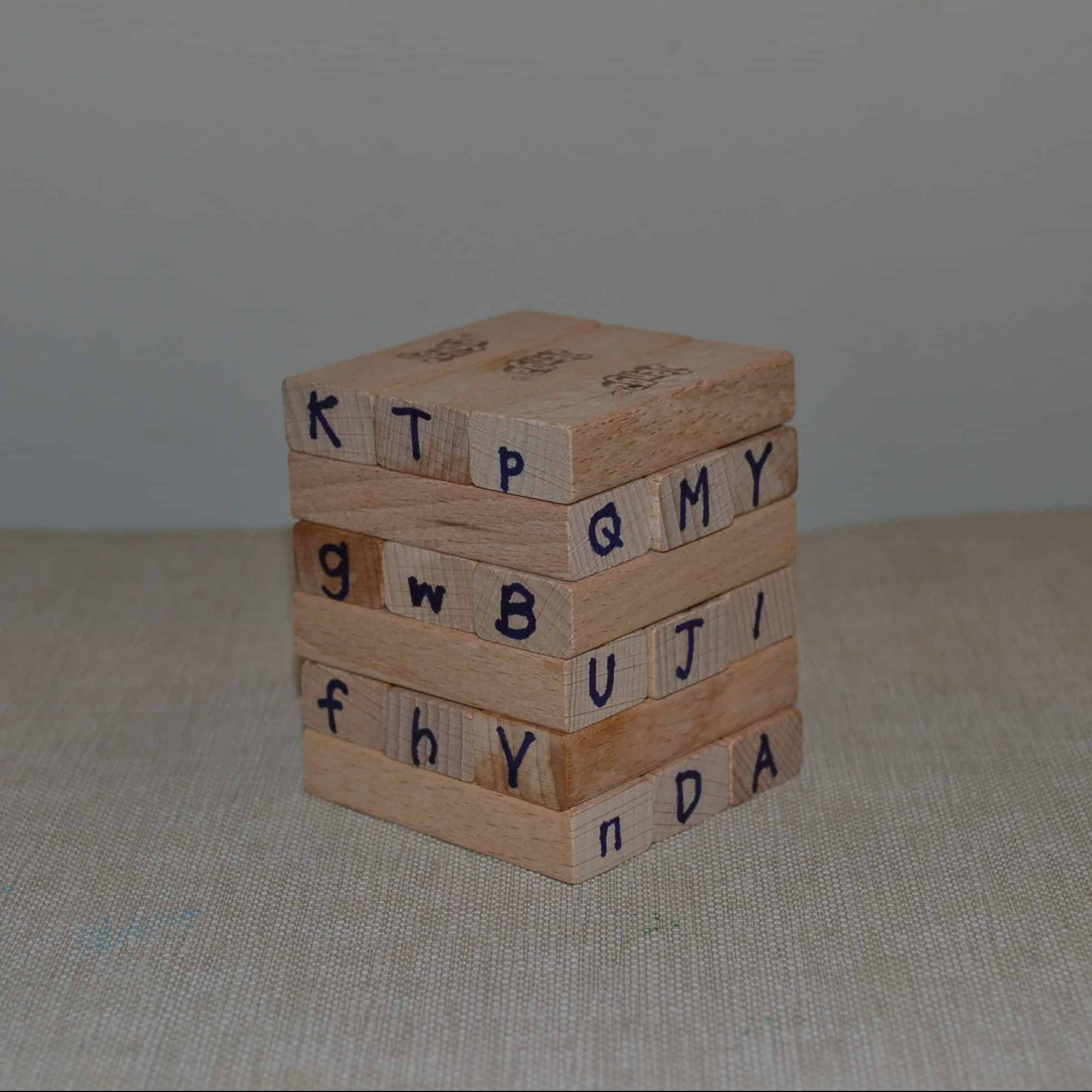 jenga blocks with letters written on them
