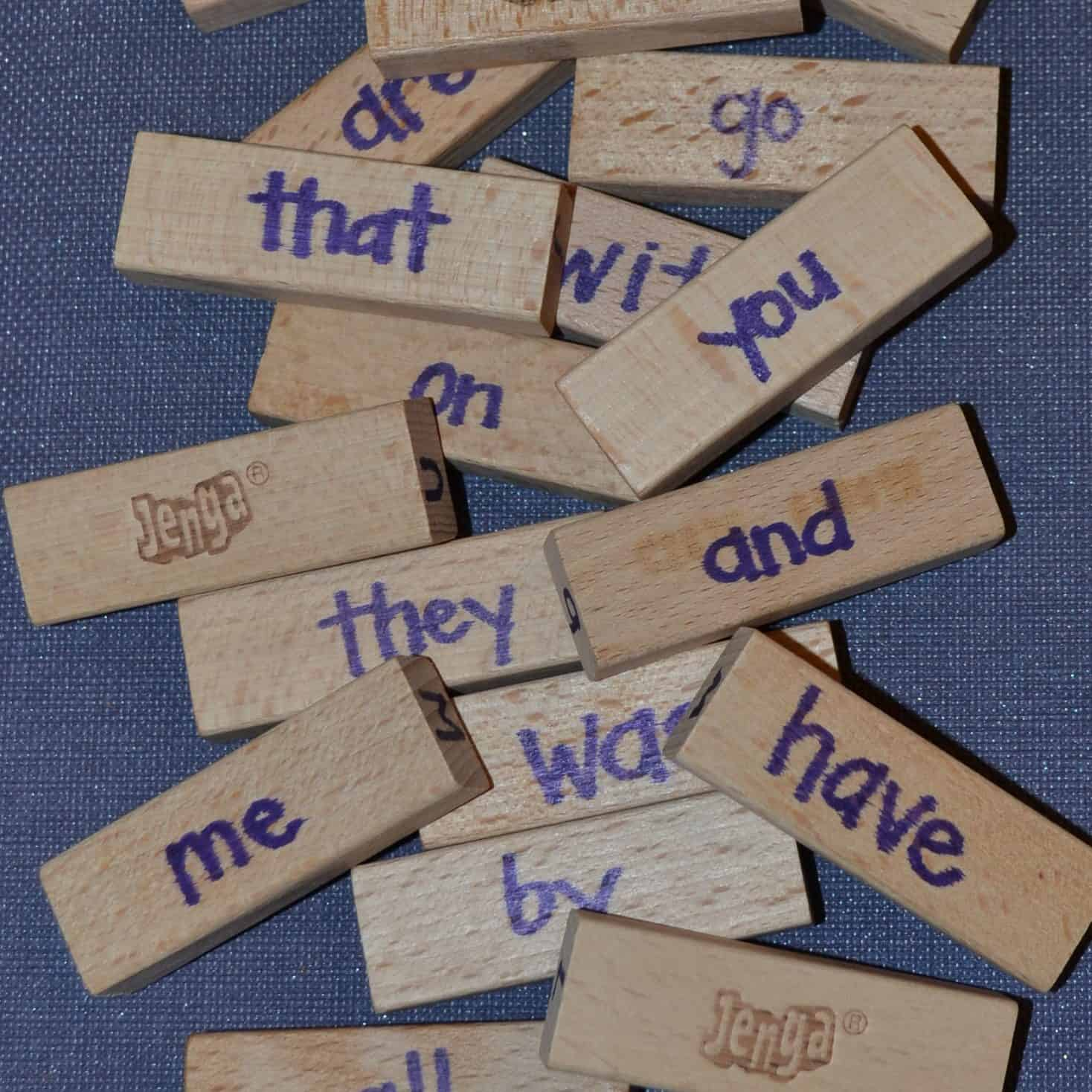 jenga blocks with sight words handwritten on them