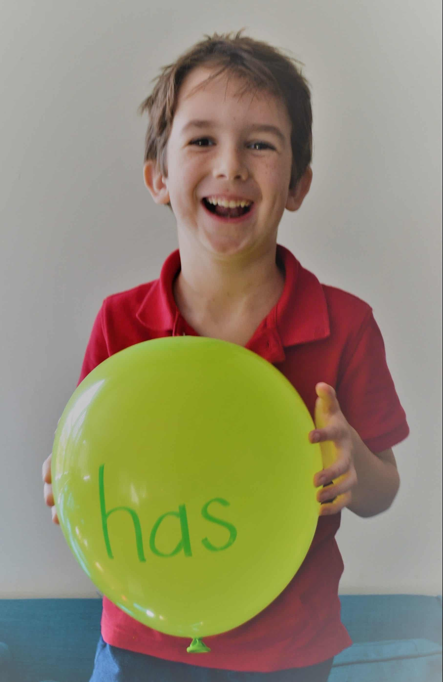 boy using balloons for sight word practice