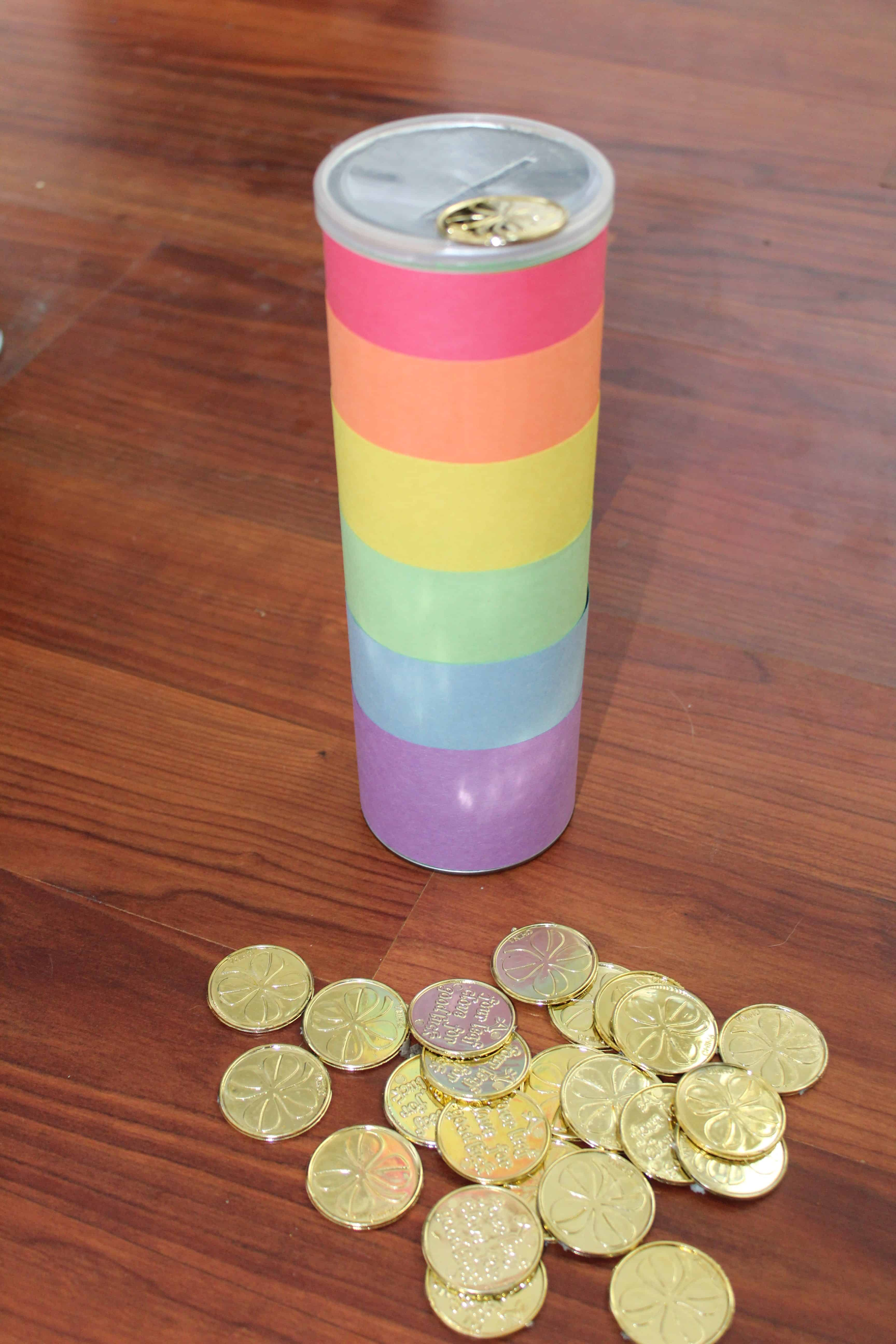 can decorated like a rainbow; slit in lid to drop gold coins into