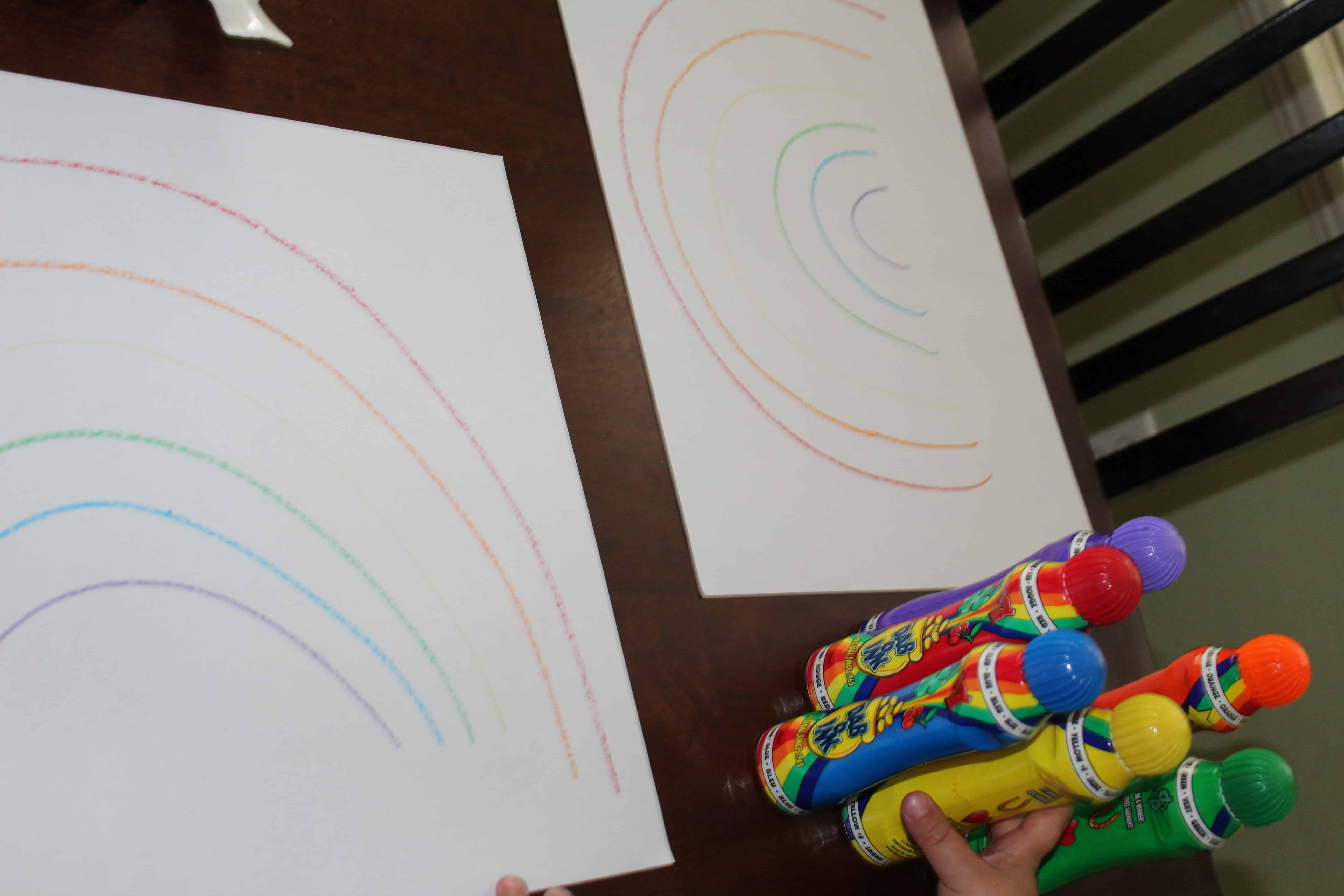 crayon lines in shape of rainbow; do a dot markers