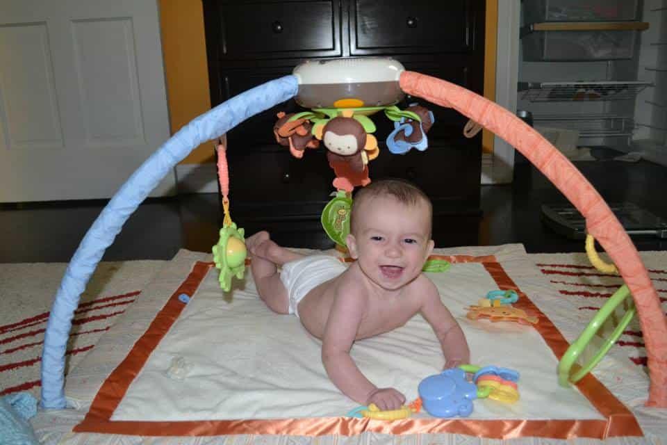 A Baby enjoying tummy time on a playmat