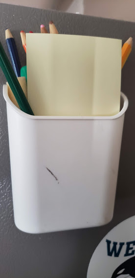 colored pencils in a magnetic caddy